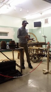 Phill Gregson Wheelwright talking to a woodcarving group