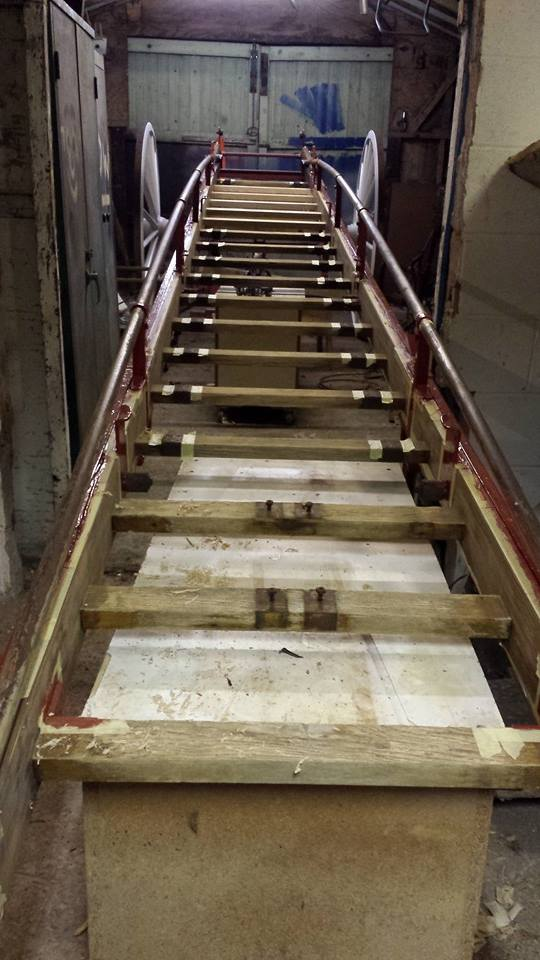 Wheeled escape ladder restoration